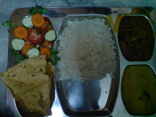 lunch - rice, dal, mutton curry, salad, papad